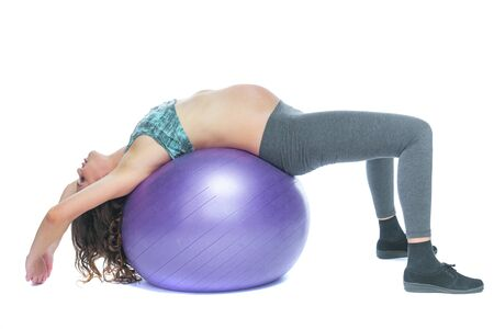Portrait of a beautiful young pregnant woman exercises with fitball. Working out and fitness, pregnancy concept. Isolated white background.