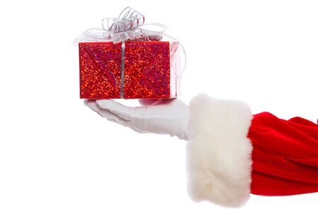 Photo of Santa Claus gloved hands holding red giftbox, isolated on white background Christmas 스톡 콘텐츠