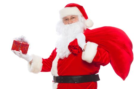 Santa Claus: Cheerful With Small Stack Of Gifts big bag, isolated on white background Christmas.
