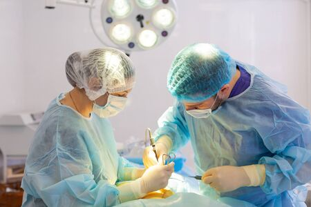 Hospital. Surgeon operates in the operating room. Surgeons save life to the injured.