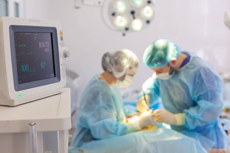 Hospital. Surgeon operates in the operating room. Monitoring of vital signs of the patient in the operating room