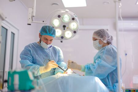Hospital. Surgeon operates in the operating room. Doctors do everything possible to treat the patient after an accident Reklamní fotografie