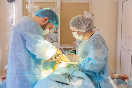 Hospital. Surgeon operates in the operating room. Surgeons perform a complex operation saving lives of victims of a terrorist attack.