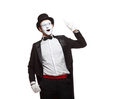 Portrait of a male mime artist performing, isolated on white background. Symbol of an idea, insight, Eureka