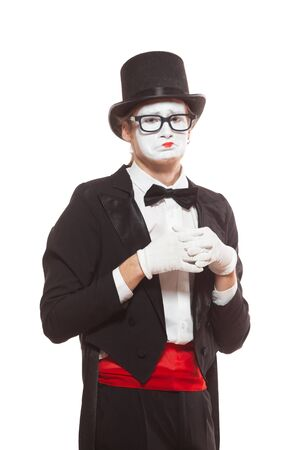 Portrait of male mime artist performing, isolated on white background. Symbol of failure, upset, bad result 版權商用圖片