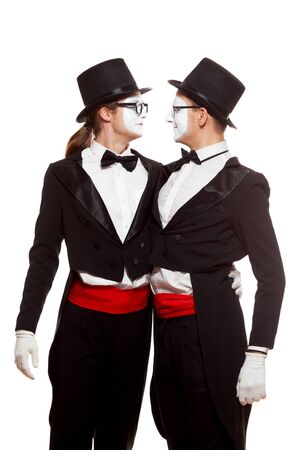 Portrait of two mime artists performing, isolated on white background. Two men embrace. Symbol of tolerance, same-sex marriage, the LGBT community 版權商用圖片