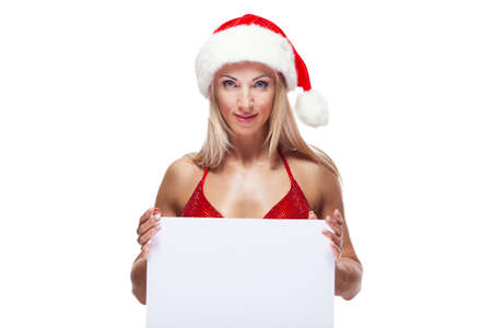 Sexy female bodybuilder in a red swimsuit and Christmas hat, copy space, isolated on white Stok Fotoğraf