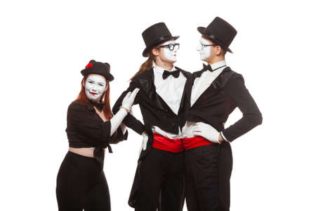 Portrait of three mime artists performing, isolated on white background. Two men embrace, and the girl is perplexed. Symbol of tolerance, same-sex marriage, the LGBT community 版權商用圖片
