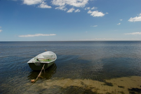 jurmala: plastic boat on the serene Baltic sea