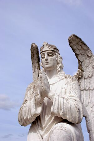 sculpture of white angel praying Stock Photo