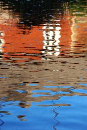 Colorful reflections in the water reminds painting stired by the wind. photo