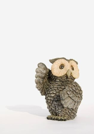 Souvenir owl with lifted wings isolated on a white background Stock Photo