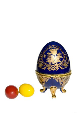 Colored Easter eggs near Faberge egg copy isolated on a white background Stock Photo - 9087865