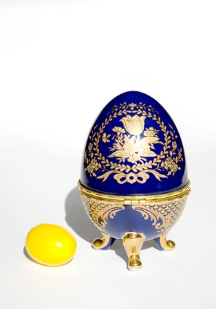 Faberge egg copy near real yellow Easter egg isolated on a white background Stock Photo - 9087868