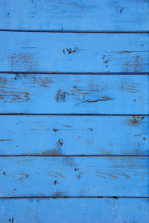 Blue grunge background of old bee hive wall.