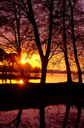 Evening sunset reflections on the lake in spring. Transparent water. Wonderful view. Stock Photo - 9653155