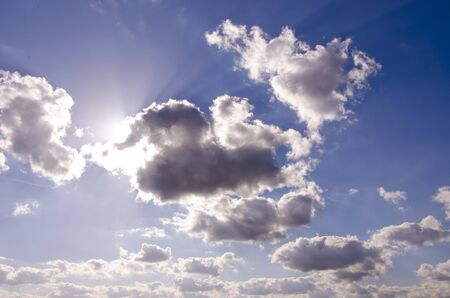 penetrate: Wonderful view of sky with some clouds. Sun rays trying penetrate through the clouds.