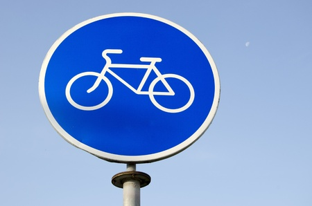 White bicycle sign in blue background. Road sign bicycle path.