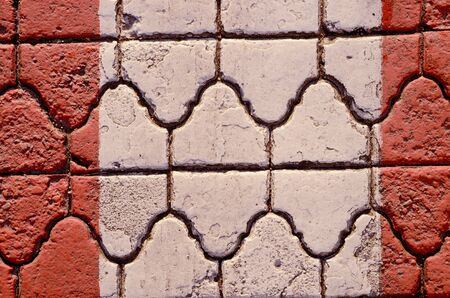 intresting: Wall fragment built of intresting bricks. Architectural background.