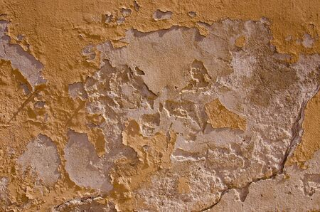 breaking down: Old breaking down wall. Fragment of an abandoned building background. Stock Photo