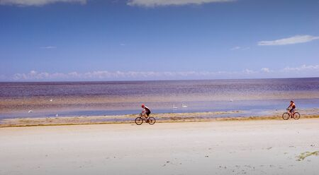 Healthiest and most pleasant cycling in summer at seaside. Active leisure.
