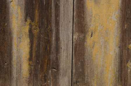 Old wooden wall fragment with interesting texture and surface background. Stock Photo