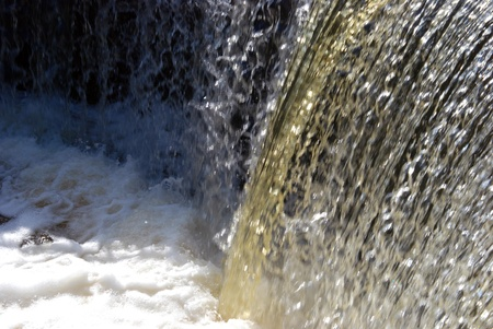 unstoppable: Waterfall water flow fragment. The unstoppable force of nature. Stock Photo