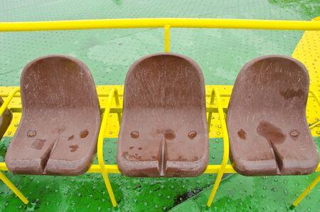 Brown plastic seats of ferry. Passenger nautical transportation details.