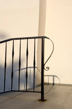Decorative metal railing fittings fragment. Architectural view.