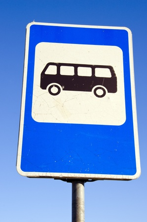 bus stop: Bus stop road sign on background of blue sky. Information sign.