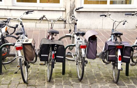 Bicycle parking place. Bicycles with carrying boxes for tourism.