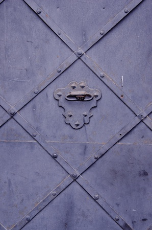 Background of ancient metal door textures and ornaments. Stock Photo
