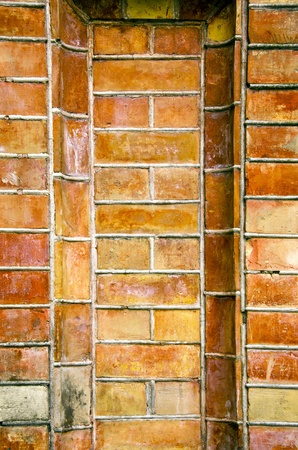 Old ancient gate made of red brick background. Architectural background. photo
