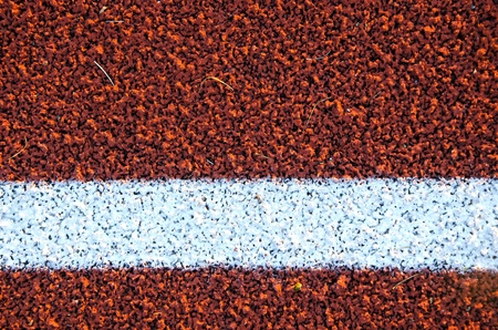 Stadium running track surface closeup background. Interesting textures.  photo