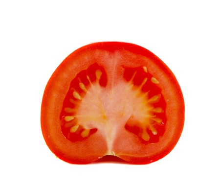 half and half: Half of cut tomatoe vegetable closeup isolated on white background. Healthy food. Nutrition.