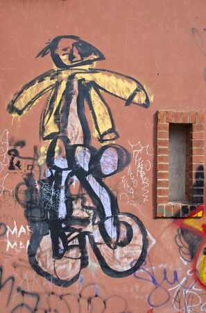 Graffiti paintings on wall. Dirty city wall. Children irresponsibility.