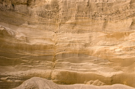 Geological layers of earth in deep sand pit.