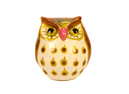 figurine: Small turkey owl decorative colored clay figurine isolated on white background.