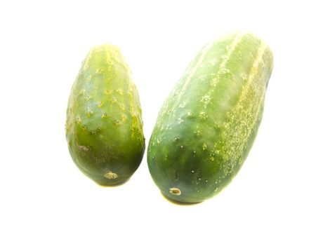Couple of green cucumber isolated on white background. Healthy natural nutrition.  photo