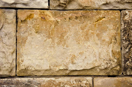 ancient building walls of large stone blocks background. Retro architecture backdrop closeup.  photo