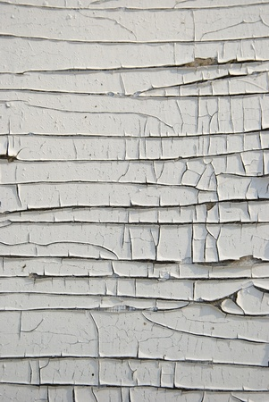 Old grunge wooden plywood board painted with white paint peeling background.  Stock Photo