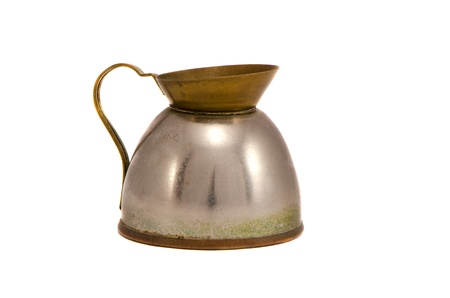 Old rusty metal kettle for boiling water isolated on white background  Grunge ancient vintage retro object   photo