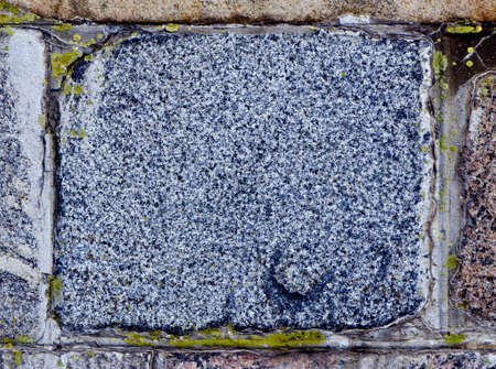 Ancient granite brick background closeup details.  photo