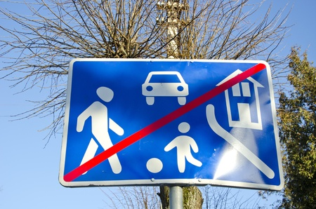 informational: Informational road sign mean end of village. Restrictions zone end.  Stock Photo
