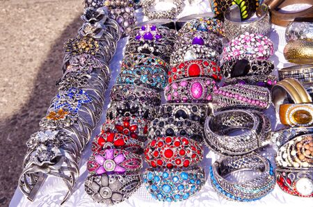 Decorative handmade jewelry bracelets and head ring sold in outdoor fair market   Stock Photo