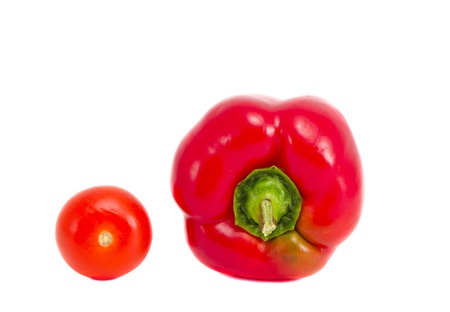 red pepper and tomato isolated on white background  healthy natural organic vegetables   photo