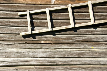 background of old retro log house wall and wooden ladder hanging Stock Photo - 13277570