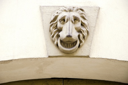 Lion symbol on ancient grunge architectural wall closeup.  photo
