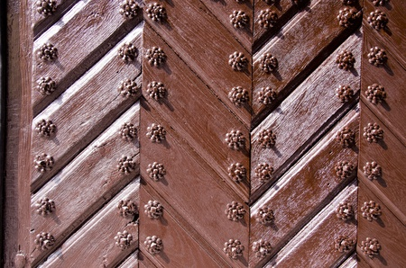 Background of ancient retro wooden door  Brown painted decorated old style door Stock Photo - 13594882