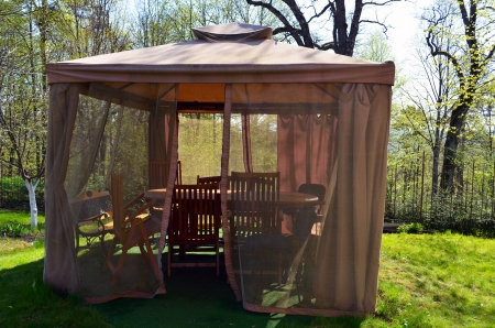 Arbor bower summerhouse with mosquito protect net, benches tables and chairs  Rest near homestead garden Stock Photo - 13800640